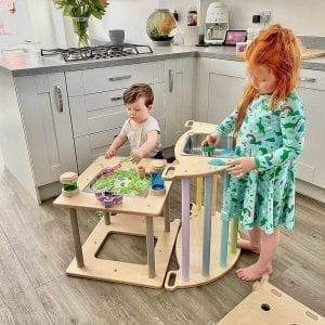 activity cube as sensory table in the kitchen