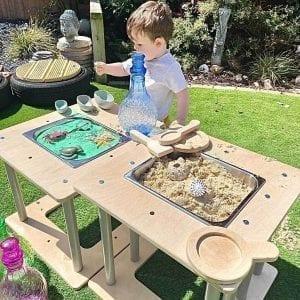 activity cube as sensory tables in the garden